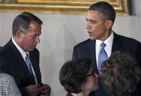 U.S. President Barack Obama talks with Speaker of the House John Boehner (R-OH) at the conclusion of the Inaugural luncheon in Statuary Hall