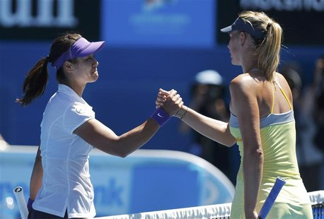 Li Na of China (L) shakes hands with Maria Sharapova of Russia after defeating her in their women's singles semi-final match at the Australi