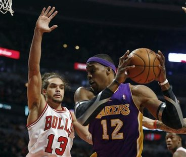 Chicago Bulls center Joakim Noah (13) defends against Los Angeles Lakers center Dwight Howard during the first half of their NBA basketball