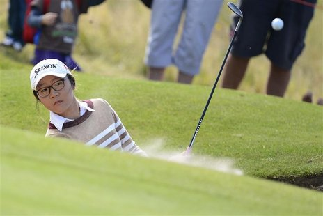 Lydia Ko of New Zealand plays her third shot from the bunker on the first hole during the second round of the British Women's Open Golf tour