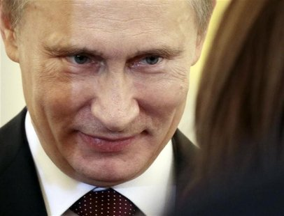 Russian President Vladimir Putin smiles during a ceremony, in which the diplomatic credentials of newly appointed ambassadors were accepted,