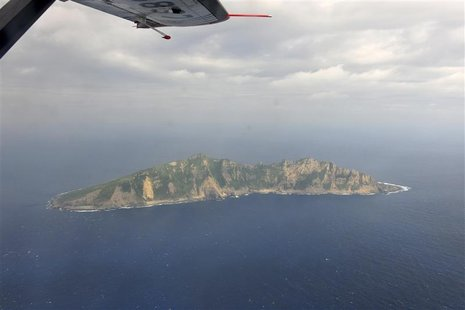 A handout photograph taken on a marine surveillance plane B-3837 shows the disputed islets, known as Senkaku in Japan and Diaoyu in China, D
