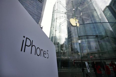 A sign of the new iPhone 5 is seen at the entrance of an Apple Store in the financial district of Pudong in Shanghai December 14, 2012. REUT