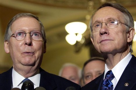 New U.S. Senate Minority Leader Mitch McConnell (R-KY) (L) and Senate Majority Leader Harry Reid (D-NV) (R) make remarks after a bipartisan