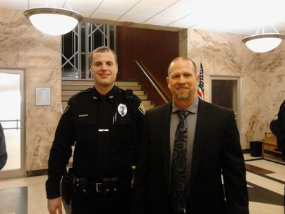 Wausau police officer Anthony Reince and Chief Jeff Hardel at Wausau City Hall after the presentation of the Life Saving Award, January 22 2013