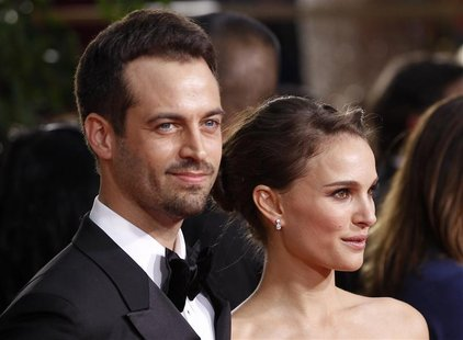 Actress Natalie Portman and partner Benjamin Millepied arrive at the 69th annual Golden Globe Awards in Beverly Hills, California January 15