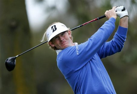U.S. golfer Brandt Snedeker hits a drive off the 11th tee of the south course at Torrey Pines during first round play at the Farmers Insuran