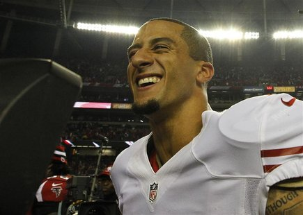 San Francisco 49ers quarterback Colin Kaepernick celebrates after defeating the Atlanta Falcons to win the NFL NFC Championship football gam