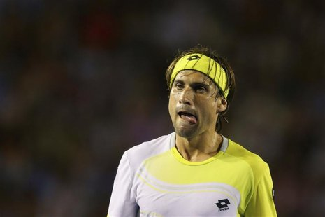 David Ferrer of Spain reacts during his men's singles semi-final match against Novak Djokovic of Serbia at the Australian Open tennis tourna
