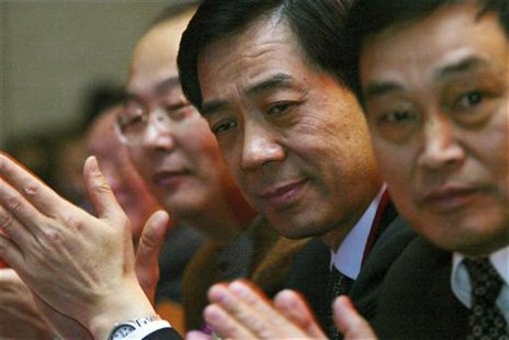 Bo Xilai (2nd R), then Governor of Liaoning Province, pauses at the China Entrepreneur Annual Meeting 2003 in Beijing in this December 7, 20