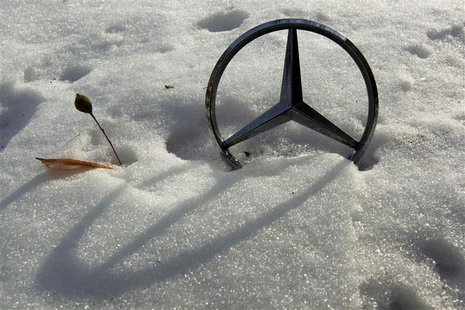 File picture shows a German car manufacturer Daimler's characteristic Mercedes-Benz star on a snow covered vehicle in Bucharest February 10,