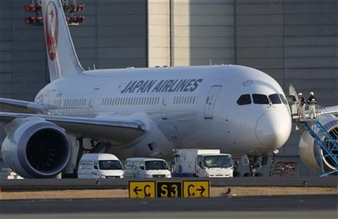Staff of Japan Airlines' (JAL) enter the company's Boeing Co's 787 Dreamliner plane at New Tokyo international airport in Narita, east of To