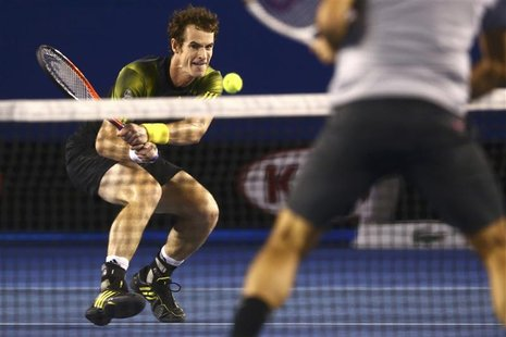 Andy Murray of Britain plays a shot to Roger Federer of Switzerland during their men's singles semi-final match at the Australian Open tenni