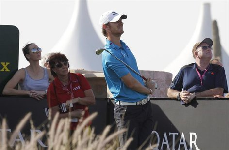 England's Chris Wood watches the ball during the third round of the Commercial Bank Qatar Masters at the Doha Golf Club January 25, 2013. RE