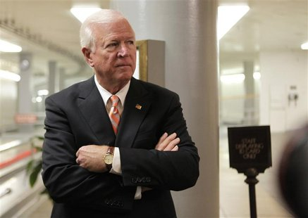 U.S. Senate Intelligence Committee vice chairman Senator Saxby Chambliss (R-GA) leaves after former CIA Director David Petraeus testified at