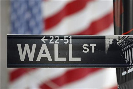 A sign for Wall Street is seen with a giant American flag in the background across from the New York Stock Exchange November 5, 2012. REUTER