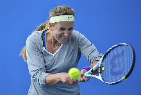 Victoria Azarenka of Belarus hits a shot during a practice session at the Australian Open tennis tournament in Melbourne January 25, 2013. R