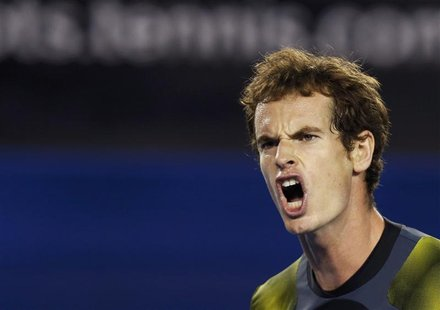 Andy Murray of Britain reacts during his men's singles semi-final match against Roger Federer of Switzerland at the Australian Open tennis t