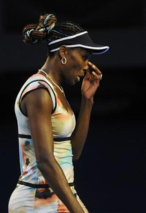 Venus Williams of the U.S. touches her nose during her women's singles match against Maria Sharapova of Russia at the Australian Open tennis