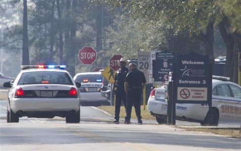 Sheriff Deputies and Houston Police stand on the street to the Lone Star College North Harris campus in Houston, Texas January 22, 2013. REU