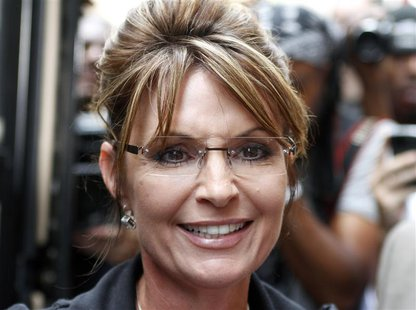 "Sarah Palin, former governor of Alaska, walks to her ""One Nation Tour"" bus after a visit to Fox News headquarters in New York, June 1, 2011."