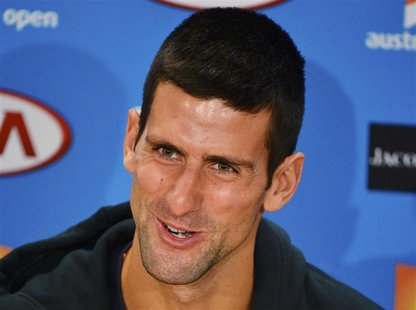 Novak Djokovic of Serbia speaks during a news conference at the Australian Open tennis tournament in Melbourne January 26, 2013. REUTERS/Tob