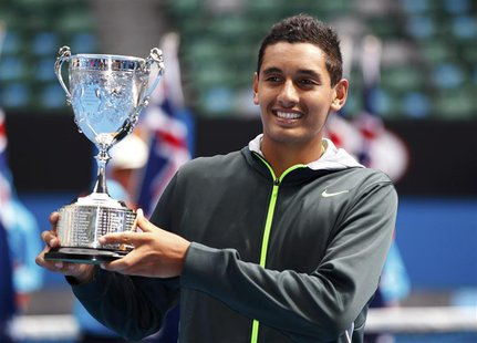 Nick Kyrgios of Australia poses with the trophy after defeating compatriot Thanasi Kokkinakis in their junior boys' singles final match at t