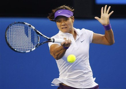 Li Na of China hits a return to Victoria Azarenka of Belarus during their women's singles final match at the Australian Open tennis tourname