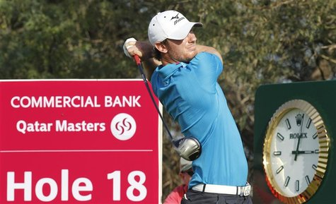 England's Chris Wood plays a shot during the third round of the Commercial Bank Qatar Masters at the Doha Golf Club January 25, 2013. REUTER