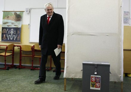 Presidential candidate and former Prime Minister Milos Zeman walks to cast his vote during the second round of the first ever direct Czech p
