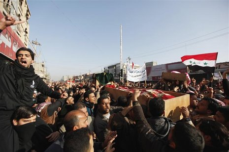Residents carry a coffin during the funeral of a victim killed in clashes with security forces in Falluja, 50 km (30 miles) west of Baghdad,