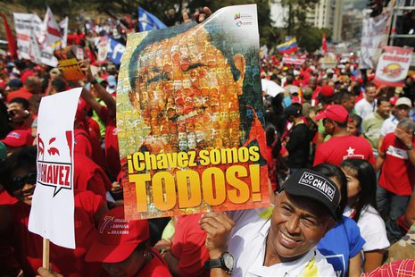 Supporters of Venezuela's President Hugo Chavez attend a rally to commemorate the 55th anniversary of the last Venezuelan dictatorship colla