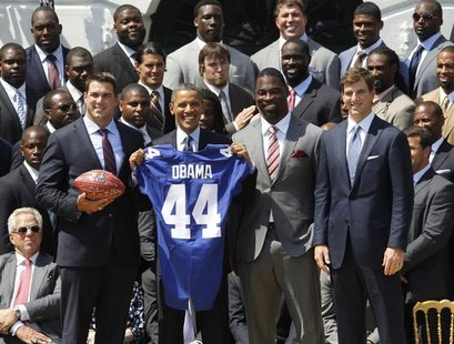 U.S. President Barack Obama (front row, 2nd L) honors the New York Giants NFL team, winners of Super Bowl XLVI, during a ceremony on the Sou