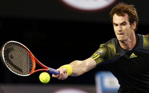 Andy Murray of Britain hits a return to Novak Djokovic of Serbia during their men's singles final match at the Australian Open tennis tourna