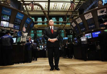 General Motors CEO Dan Akerson stands on the floor of the New York Stock Exchange during an interview November 18, 2010. REUTERS/Shannon Sta