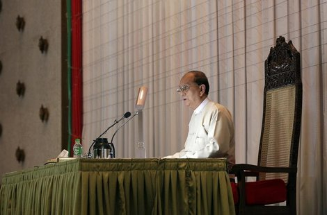 Myanmar's President Thein Sein speaks during a meeting with representatives from civil societies at the Yangon Region Parliament Building in