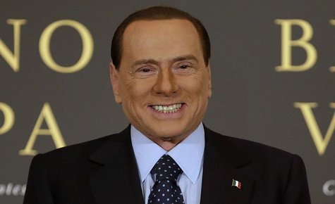 Former Italian Prime Minister Silvio Berlusconi smiles as he arrives to attend the book launch of his friend, TV presenter Bruno Vespa, in R