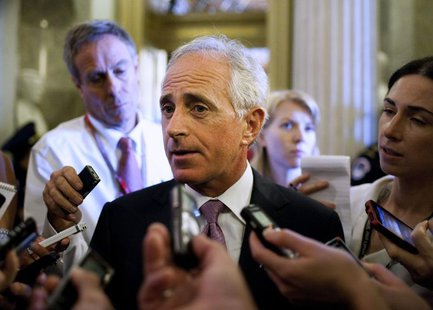 Senator Robert Corker (R-TN) speaks to the media before voting on a bill allowing a rise in the debt ceiling on Capitol Hill in Washington i
