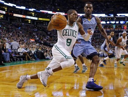 Boston Celtics guard Rajon Rondo (9) drives to the basket against Memphis Grizzlies guard Tony Allen in the second half of their NBA basketb