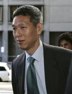 Then SingTel Chief Executive Lee Hsien Yang arrives at the Federal Court in Sydney in this April 5, 2006 file photo. REUTERS/Will Burgess/Fi