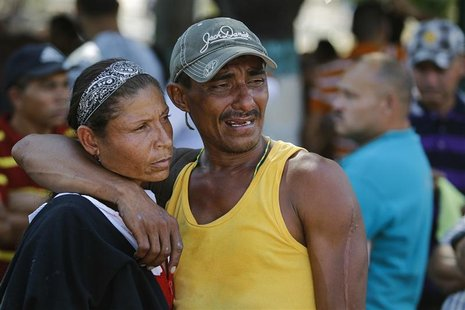 Relatives of an inmate of the Centro Occidental (Uribana) prison who died during the uprising at the prison cry outside a morgue in Barquisi