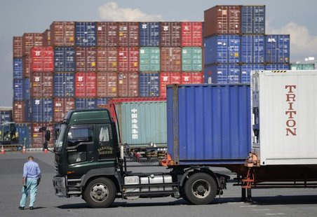 A worker walks at a container depot, near an industrial port in Tokyo September 10, 2012. REUTERS/Toru Hanai