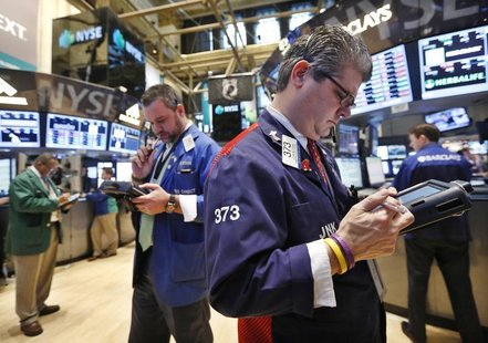 Traders work on the floor of the New York Stock Exchange, January 23, 2013. REUTERS/Brendan McDermid