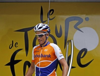 Rabobank rider Grischa Niermann of Germany arrives at the sign-in podium with a fake antenna on his helmet before the start of the tenth sta