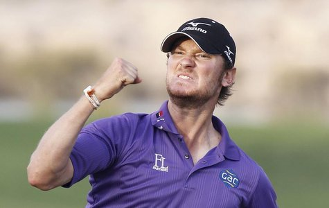 Chris Wood of England celebrates after his eagle putt on the 18th green during the final round of the Commercial Bank Qatar Masters at the D