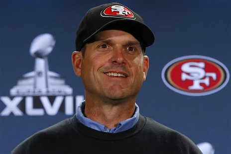 San Francisco 49ers head coach Jim Harbaugh speaks during a news conference after the team's arrival for the NFL's Super Bowl XLVII in New O
