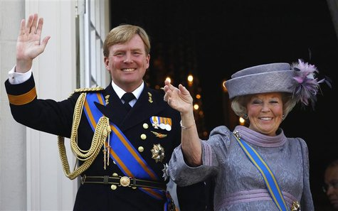 Netherlands' Queen Beatrix (R) and her son Crown Prince Willem-Alexander are seen waving to well-wishers from the balcony of the Royal Noord