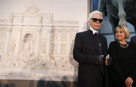 German designer Karl Lagerfeld (L) and Creative Director of Fendi, Silvia Fendi arrive to attend a news conference to present a project of c