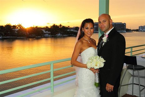 Lazaro Sopena poses with Hann Dinh on their wedding day in Miami Beach, Florida, in this July 2, 2011 handout photo. Sopena opted to take hi