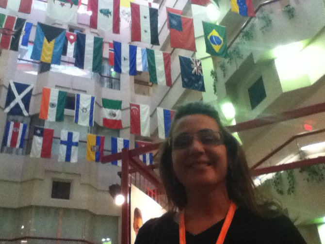 Charli with the flags of the nations of St. Jude Children's Hospital patients
